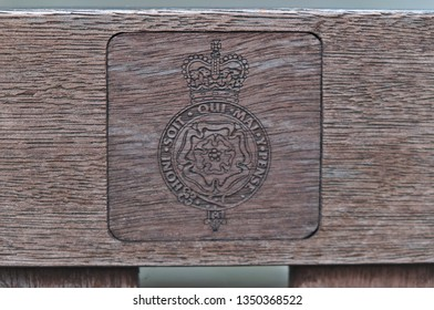 London, England / United Kingdom - December 09 2017: Coat of Arms on wooden park bench in London