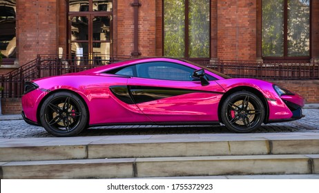 London, England / United Kingdom - June 13 2020: Pink McLaren super car in front of St. Pancras Renaissance Hotel