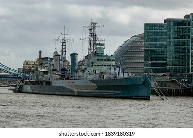 In London, England, United Kingdom n 02/15/2020. From the other bank of the Thames is the imposing HMS Belfast, the historic warship.