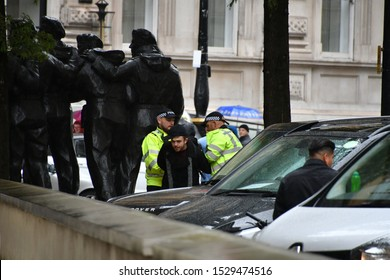 London, England/ United Kingdom October 12 2019: Man being arrested for disordely behaviour in central London westminster arear .