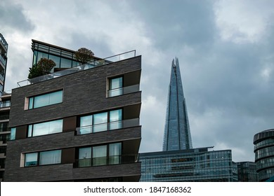 In London, England, United Kingdom on 02/23/2020. Modern residential building at the bottom of which is The Shard building.