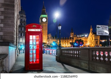London, England, United Kingdom - Popular tourist Big Ben and Houses of Parliament with red phone booth in night lights illumination