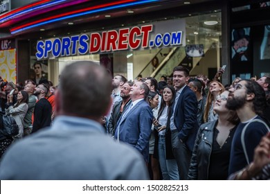London, England, United Kingdom- September 12, 2019: Entrepreneur, and owner Mike Ashley watches Alec Monopoly abseil down the side of the building during the Opening of Flannels London on Oxford St.