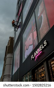 London, England, United Kingdom - September 12, 2019: Opening of Flannels London on Oxford St. sees Alec Monopoly abseil down the side of the building.