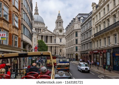 London. England. United Kingdom. UK. 06/04/2018.  The upper tier of the sightseeing bus against the background of old buildings