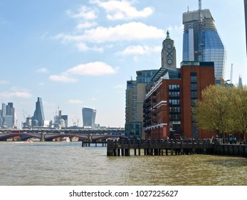 London, England-04/11/2017: Thames river in London with the buildings along the Queens walk