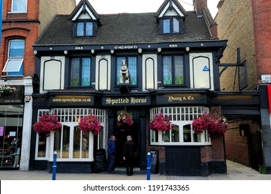 LONDON, ENGLAND-4 JULY 2013: People in front of beautiful building of The Spotted Horse, is galloping back to Putney high street with a brand new botanical look following an extensive refurbishment