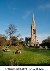 London, England/UK - 2/22/2019: This vertical image shows Clissold Park, Stoke Newington, with spire of St Mary's church in the distance