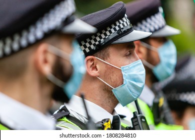 london, England/uk - august 30th 2020: police officers wearing ppE and face mask during black live matter protest from nottinghill to hyde park