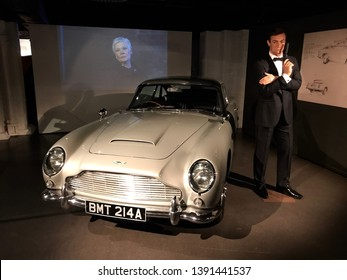 London, England/UK. June 17, 2017. A display of the  Aston Martin DB5 vehicle that was used in a James Bond Film next to a figure of Sean Connery as Bond.
