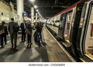 London Euston station, London, UK. March 30, 2017. Busy commuters disembarking from trains onto the platforms at London Euston train station terminus of West Coast line.