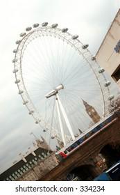 London Eye behind passing train