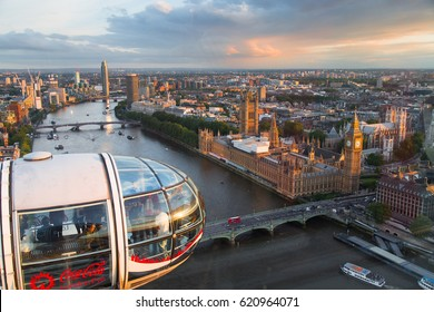 LONDON EYE - JUNE 5, 2016: London Eye (135 m tall, diameter of 120 m) is a famous tourist attraction over river Thames in London and view of the London Eye at sunset is very beautiful.