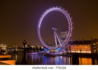 The London Eye overlooking the Thames at night