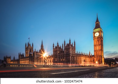 London famous view. Long exposure shot of Big Ben, Westminster bridge and House of parliament. Evening scene.