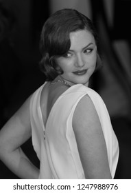LONDON - FEB 08, 2015: ( Image digitally altered to monochrome ) Holliday Grainger attends the EE British Academy Film Awards at The Royal Opera House