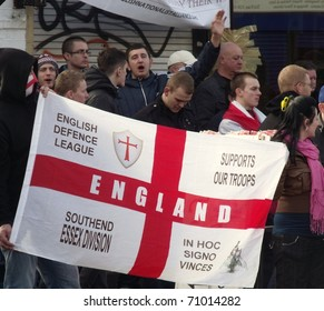 LONDON - FEB 12: English defence league protesters demonstrate behind police lines, against londons latest mosque being built at Dagenham, london, feb 12, 2011.