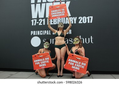 LONDON - FEB 17, 2017: Activists from PETA protest against the use of Crocodile skins at Autumn Winter 2017, London Fashion Week on Feb 17, 2017 in London