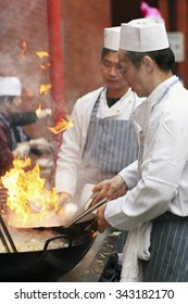 LONDON - FEB 18 : Chinese chefs working at Chinese New Year celebrations in London's Chinatown on Feb18, 2007, London, UK. Various traditional performance attract thousands of people to the street.