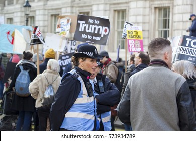 LONDON - FEBRUARY 04, 2017: Political protesters taking part in the NO MUSLIM BAN demonstration against president Donald Trump's ban on people from 7 Muslim countries entering the USA.