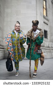 LONDON - FEBRUARY 15, 2019: AMEN Interior Fashion is made up of South African fashion, interior designers Brad Muttitt, Abiah SuperStar Mahlase for London Fashion Week. They wear wildly colorful coat
