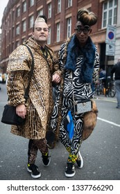 LONDON - FEBRUARY 15, 2019: AMEN Interior Fashion is made up of South African fashion, designers Brad Muttitt, Abiah SuperStar Mahlase for London Fashion Week. They wear wildly colorful coat