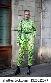 LONDON - FEBRUARY 15, 2019: guest is seen on the street wearing neon green snakeskin pattern jumpsuit with neon bag during London Fashion Week