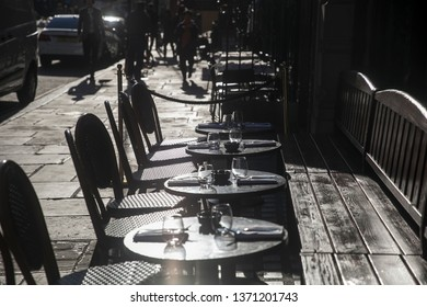 LONDON - FEBRUARY 15, 2019: Outdoor cafe with tables in backlight