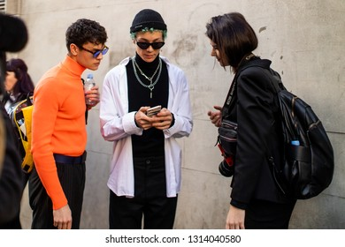 LONDON - FEBRUARY 15, 2019: Stylish attendees gathering outside 180 The Strand for London Fashion Week wearing personalised overcoats.