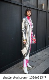 LONDON - FEBRUARY 15, 2019: Stylish attendees gathering outside 180 The Strand for London Fashion Week. girl in a silver coat and pink tracksuit