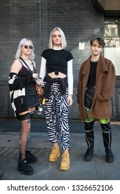 LONDON - FEBRUARY 15, 2019: Stylish attendees gathering outside 180 The Strand for London Fashion Week. two blond girls and boy pose