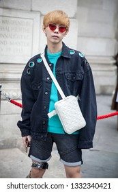 LONDON - FEBRUARY 15, 2019: Stylish attendees gathering outside 180 The Strand for London Fashion Week.Fashion blogger Jacob Withu wears  in a short jacket and shorts
