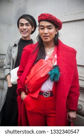 LONDON - FEBRUARY 15, 2019: Stylish attendees gathering outside 180 The Strand for London Fashion Week. Man in red beret and suit
