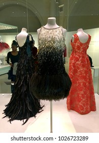 LONDON - FEBRUARY 17, 2017: Evening dresses by Yves Saint Laurent on display at the Balenciaga exhibition at The Victoria & Albert Museum in South Kensington, London, UK.