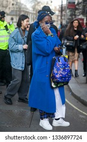 LONDON - FEBRUARY 17, 2019: Stylish attendees gathering outside 180 The Strand for London Fashion Week.
