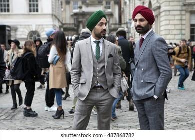 LONDON - FEBRUARY 18: Stylish Sikh men poses for photographers  outside Somerset house during London Fashion week on February 18, 2014. London Fashion Week on February 18, 2014 in London.