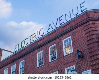 LONDON- FEBRUARY, 2018: Electric Avenue neon sign on the edge of Brixton Road. A famous shopping street  in this vibrant part of south west London