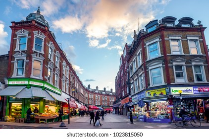LONDON- FEBRUARY, 2018: Wide angle view of Brixton's Electric Avenue. A famous London shopping street and home of Brixton Market and interesting food outlets.