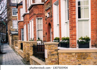 LONDON- FEBRUARY, 2019: An attractive street of red brick terraced houses in Battersea, south west London