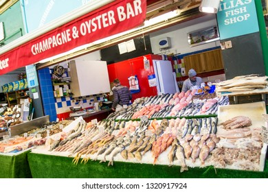 LONDON- FEBRUARY, 2019: A fishmongers stall inside Brixton Market, a famous food market in south west London