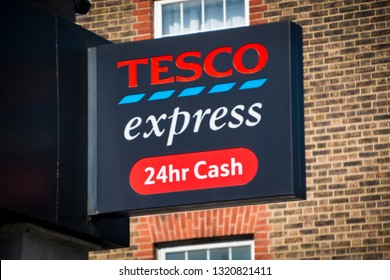 LONDON- FEBRUARY, 2019: Tesco Express exterior sign, a large British multinational groceries retailer