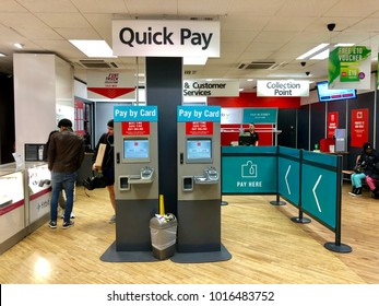 LONDON - FEBRUARY 3, 2018: Customers order, pay and collect inside Argos, and online an high street catalogue retailer, on the Finchley Road, London, UK.