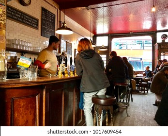 LONDON - FEBRUARY 4, 2018: Customers buy drinks at The Southampton Arms, an Ale and Cider House stocking alcoholic beverages from only small independent UK breweries, in Kentish Town, London, UK.
