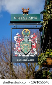LONDON - FEBRUARY 8, 2018. A suspended sign at The Rutland Arms pub on Lower Mall, overlooking the River Thames at Hammersmith, west London, UK.