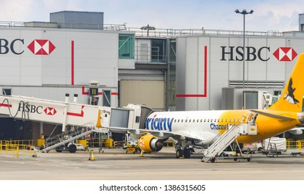LONDON GATWICK AIRPORT, ENGLAND - APRIL 2019: Embraer 195 plane operated by Aurigny on stand at the South Terminal of London Gatwick airport. The airline is based in the Channel islands.