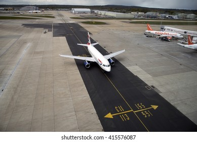 LONDON GATWICK AIRPORT SOUTHERN ENGLAND UK - APRIL 2016 - A passenger jet using a taxiway which has just been resurfaced