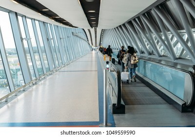 London Gatwick, March 15th, 2018: Passengers at horizontal escalator covered by a modern tunnel at London Gatwick's North Terminal