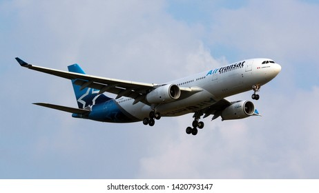 London Gatwick Sussex UK July 2018 Air Transat Airbus A330 landing at Gatwick over Charlwood on runway 08R