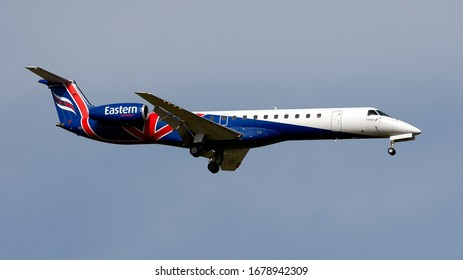 London Gatwick West Sussex UK March 21st 2020 : Eastern ERF small commuter jets landing at the airport on 08R runway