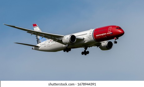 London Gatwick West Sussex UK March 21st 2020 : Norwegian 787 landing at the airport 08R